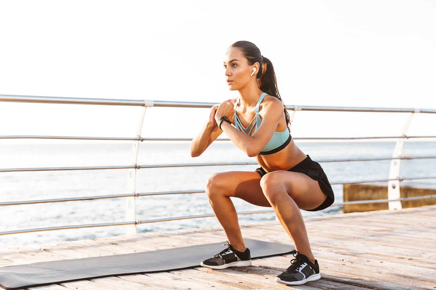 how to stay active, woman doing squats